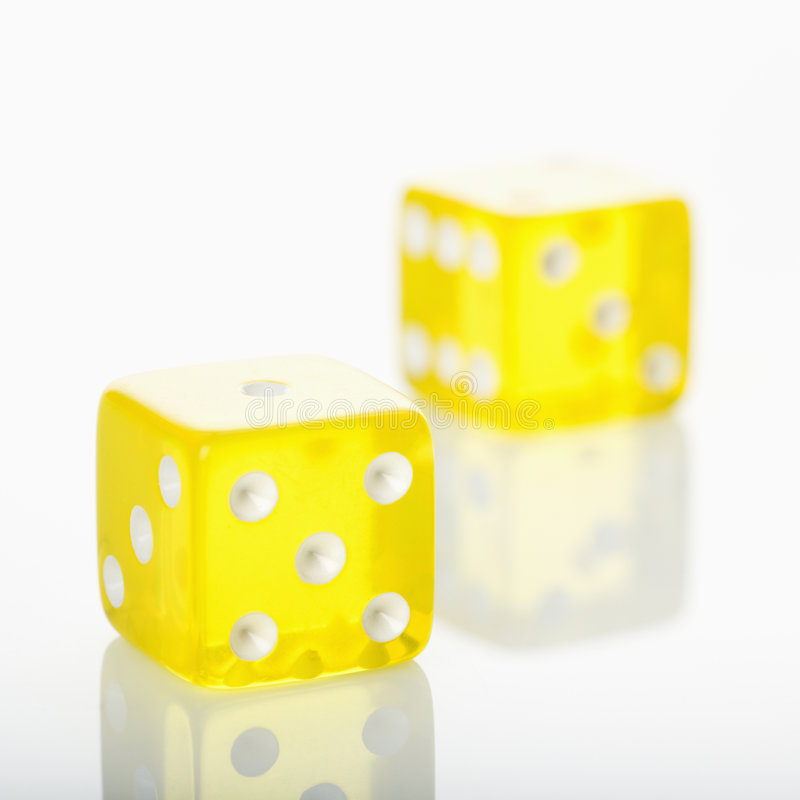 Yellow dice. stock photos