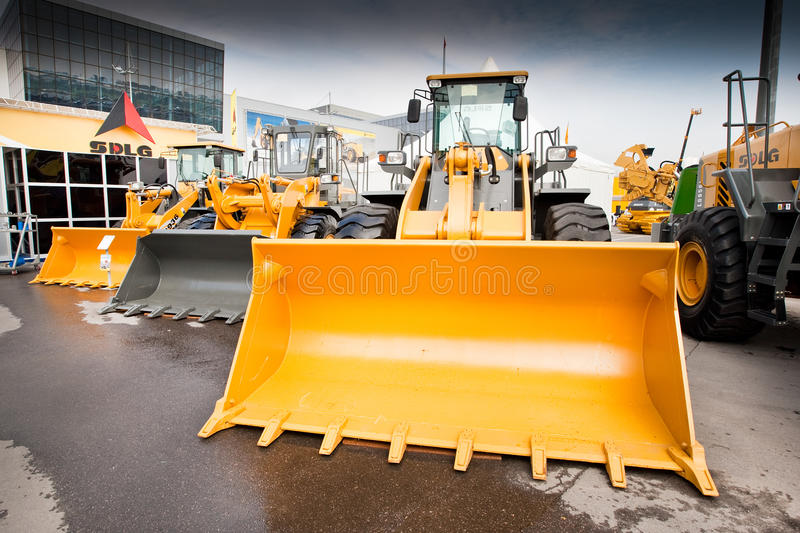 Yellow diesel front end loader. MOSCOW, RUSSIA - JUNE 02: Yellow diesel front end loader on display at Moscow International exhibition Construction equipment and stock photo