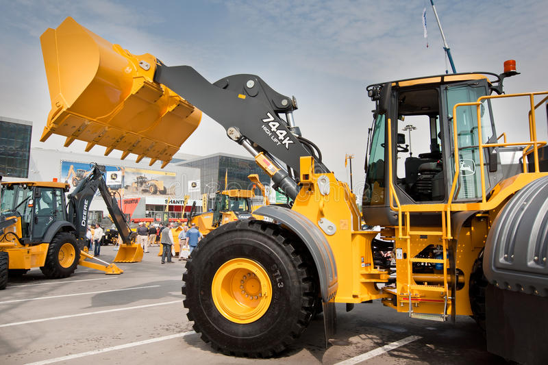Yellow diesel front end loader. MOSCOW, RUSSIA - JUNE 02: Yellow diesel front end loader on display at Moscow International exhibition Construction equipment and stock images