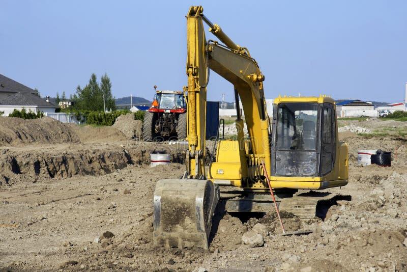 Download Yellow Digger At Big Job Site Royalty Free Stock Photos - Image: 20233338