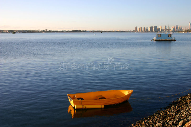 Yellow Dinghy. Early morning sun on a yellow dinghy stock image