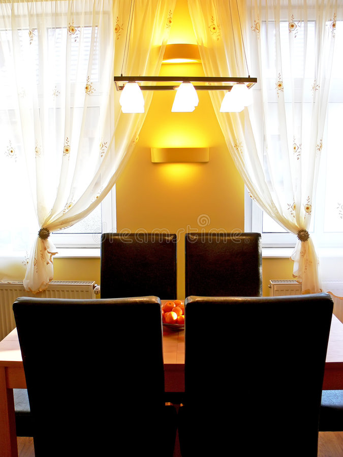 Yellow dining room royalty free stock images