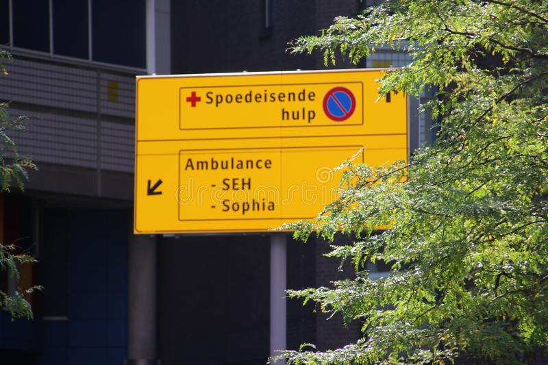 Yellow direction sign to the ER of the Erasmus medical center of the Sophia children hospital royalty free stock images