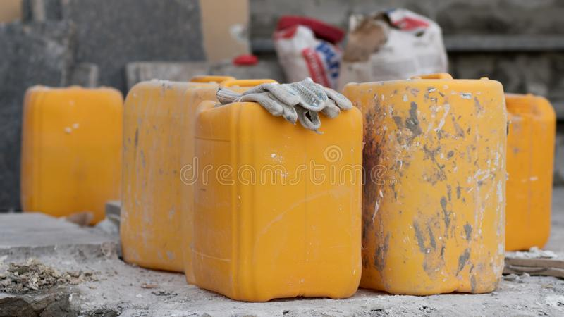 Yellow dirty canisters on the ground royalty free stock photography