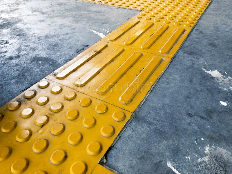 Yellow Dome and Block of Tactile Paving Which Act as A Guidance for Visually Impaired or Blind Citizen To Avoid Hazard. On Street or Public Transport Such as royalty free stock image
