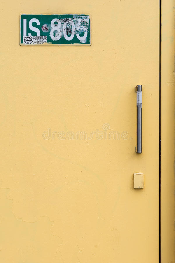 The yellow door. Industrial minimalism on the Seine docks royalty free stock image