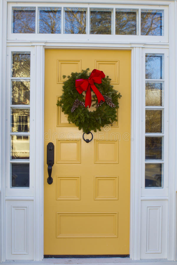 Yellow Door with Wreath stock photography