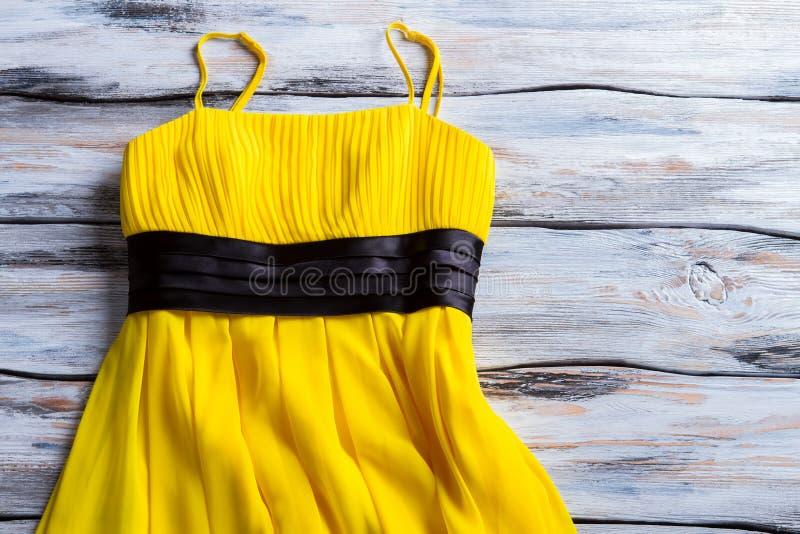 Yellow dress with thin straps. stock photo