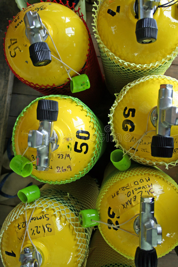 yellow ean nitrox scuba diving tanks royalty free stock photo