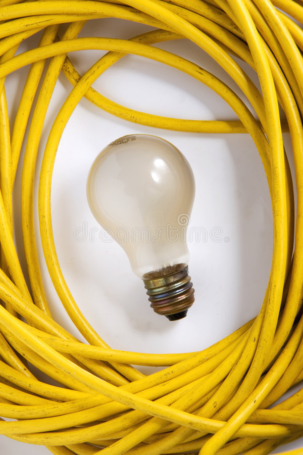 Yellow electric cable and light bulb stock photos