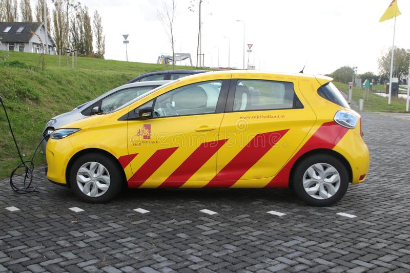 Yellow electric car loading, car used by the state provincie of Zuid Holland in the Netherlands royalty free stock photo
