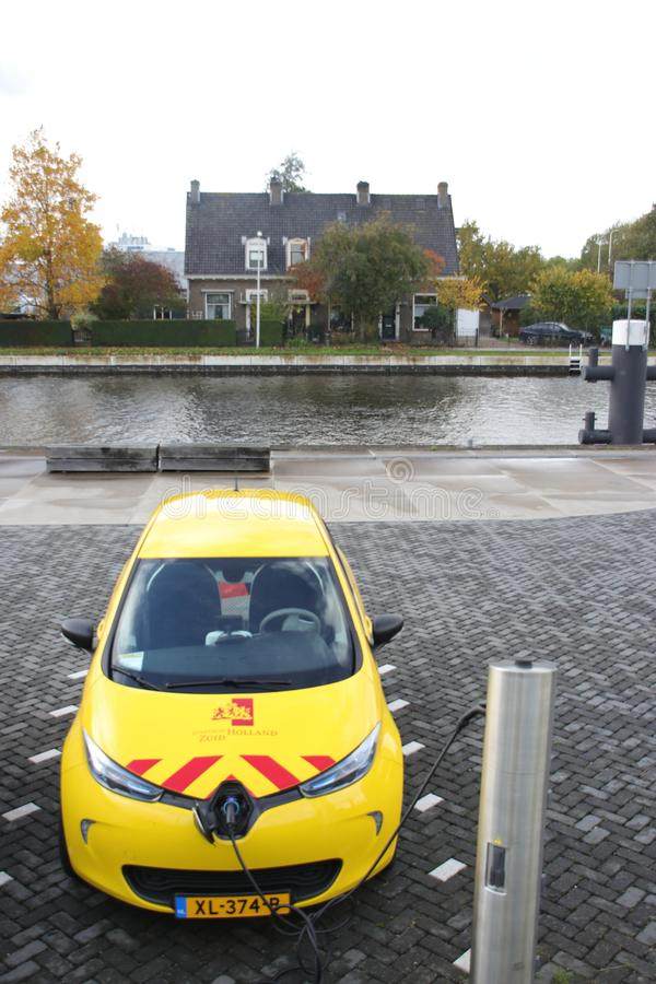 Yellow electric car loading, car used by the state provincie of Zuid Holland in the Netherlands stock photo