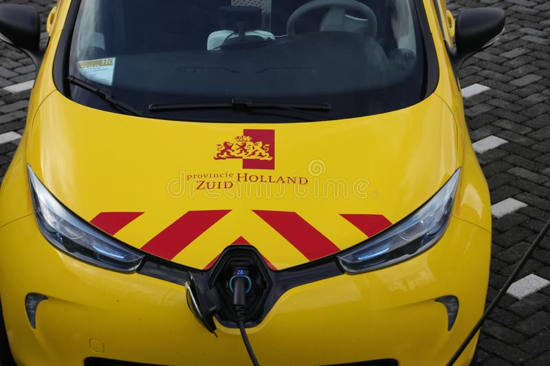 Yellow electric car loading, car used by the state provincie of Zuid Holland in the Netherlands royalty free stock photos