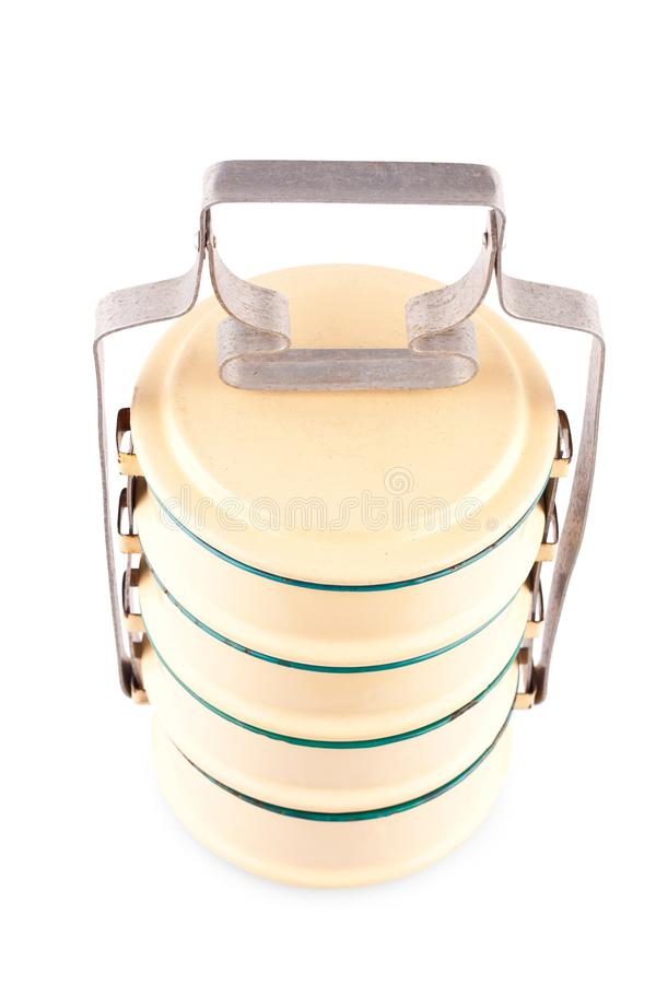 Yellow enamelled food carrier top view on white background kitchenware object isolated stock image