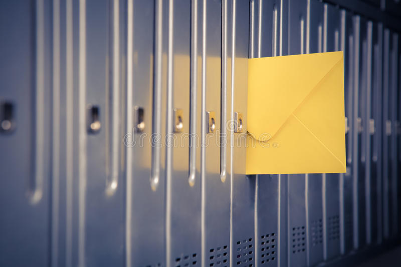 Yellow envelope sticking out from a mailbox stock photography