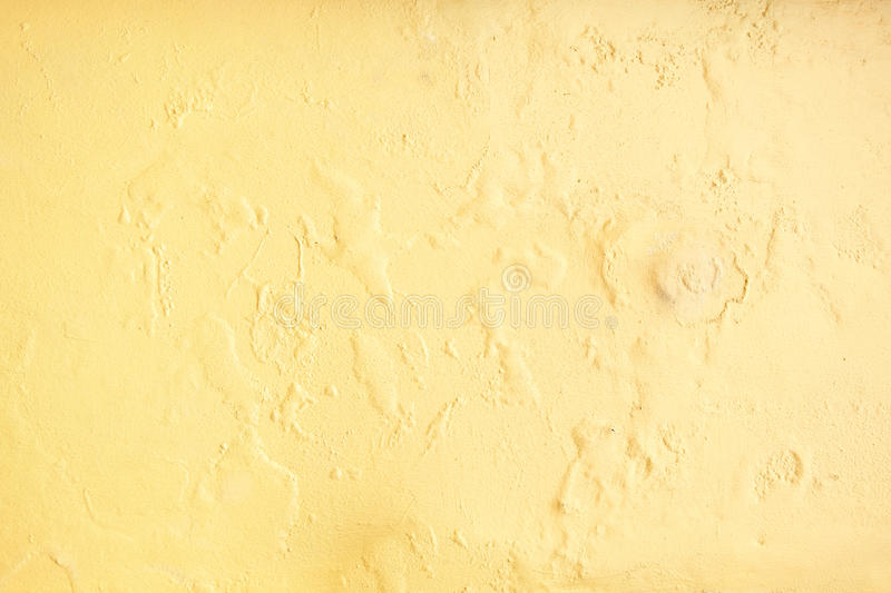 Yellow erode painted concrete wall,grunge rough texture background.  stock images