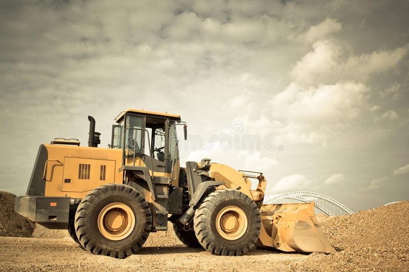 Yellow Excavator. At Construction Site royalty free stock image
