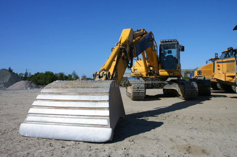 Download Yellow excavator stock image. Image of build, blue, industry - 6917607