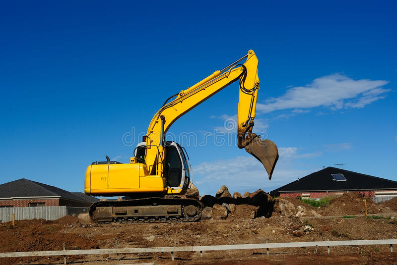 Yellow Excavator At Work. Yellow excavator on a construction site stock images