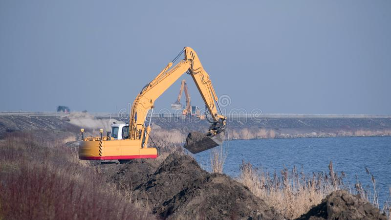 Yellow excavators at one of the major waterworks in the Netherlands royalty free stock photos