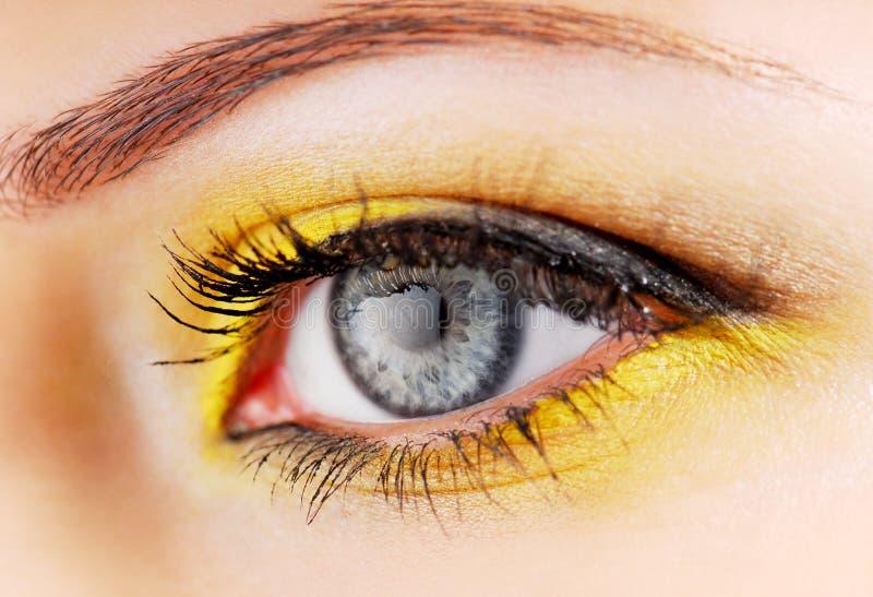 Yellow eyeshadow. Beauty. Woman eye with yellow eyeshadow royalty free stock photography