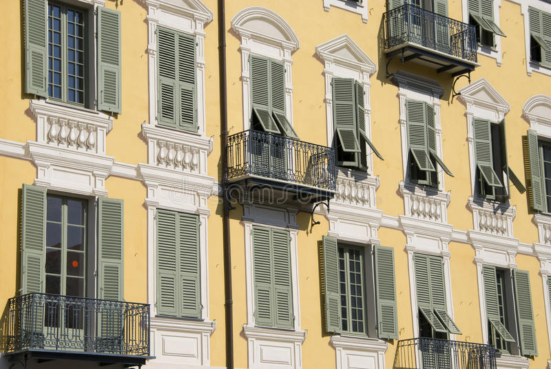 Yellow facade building with fake stucco, nice stock images