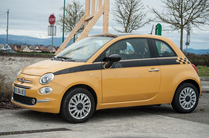 Yellow fiat 500 parked on rural road royalty free stock photos
