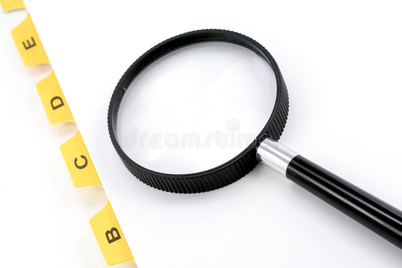 Yellow File Divider And Magnifier Royalty Free Stock Photo