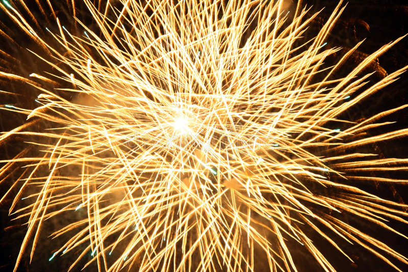 Yellow fireworks burst royalty free stock photography