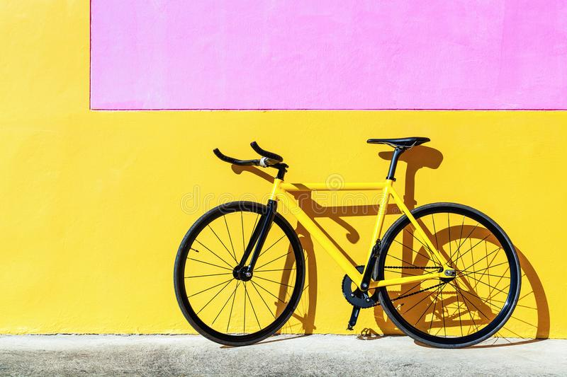 Yellow fixed gear bicycle royalty free stock photos