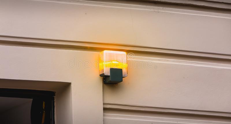 Yellow flashing light at the exit of a parking lot. In Italy stock photos