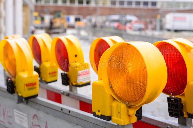 Yellow flashing light standing at road construction site. Road works concept. Yellow flashing light standing at road construction site. Road works concept royalty free stock photography