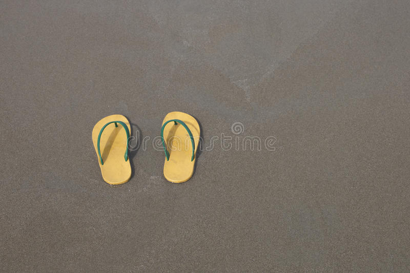 Download Yellow Flip-flops Footware Pair On The Beach Sand Stock Photo - Image: 83708152