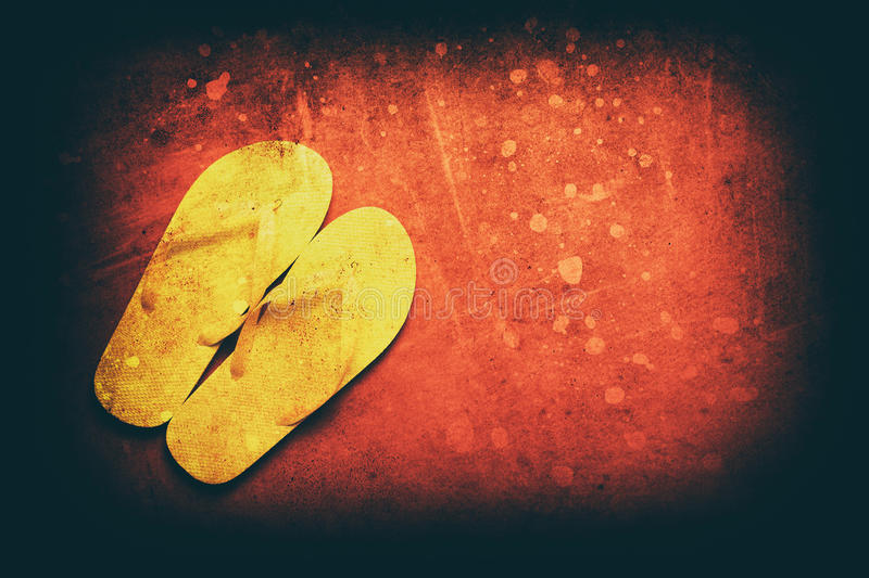 Yellow flip-flops. On a red wooden background royalty free stock photos