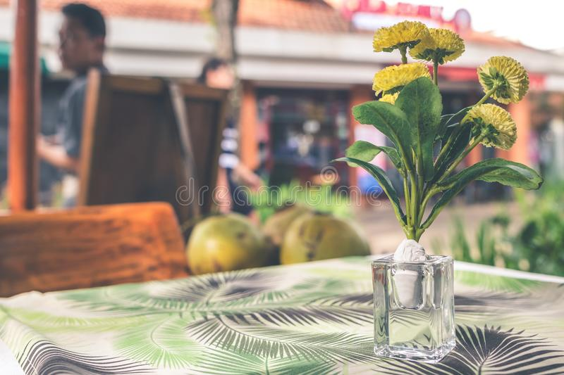 Yellow Flower Arrangement in Vase on Top of Table royalty free stock photography