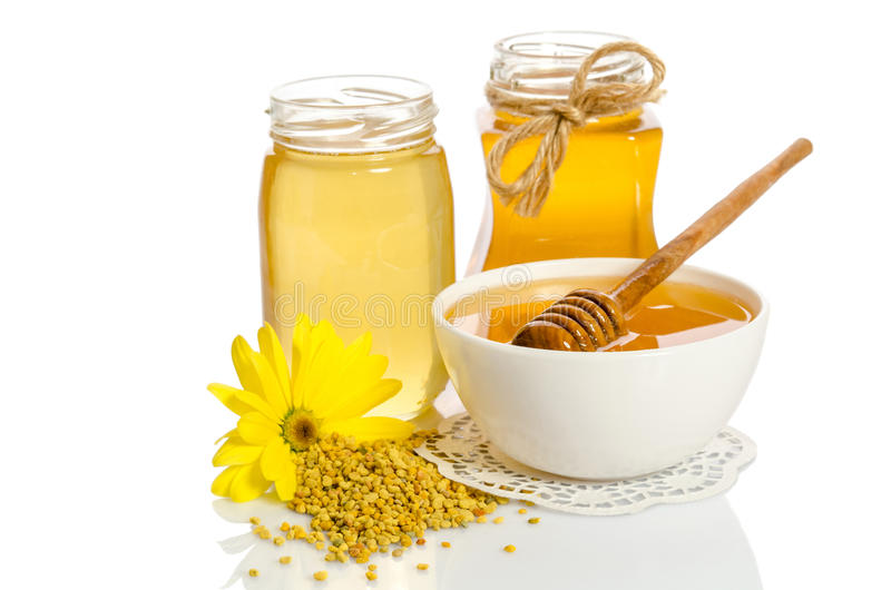 Yellow flower and bee products & x28;honey, pollen& x29; stock images
