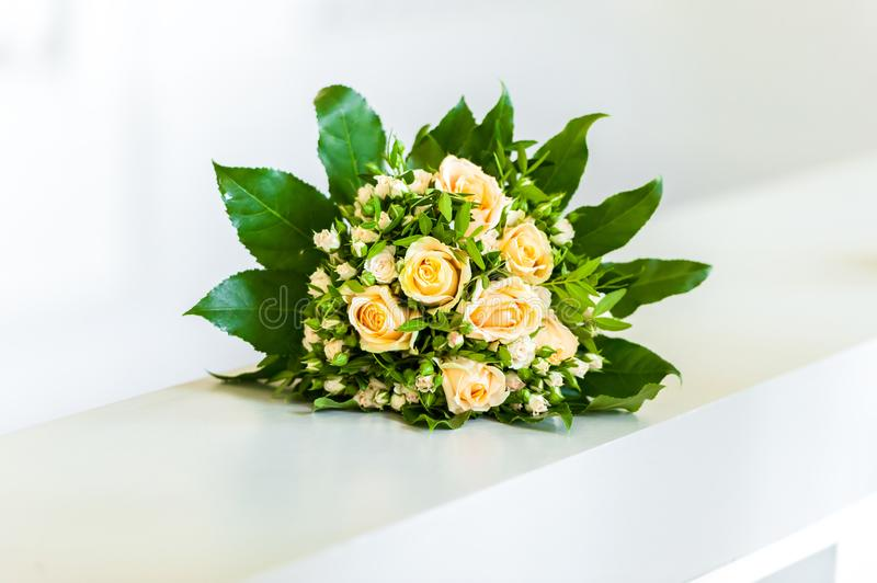 Yellow flower bouquet on white handle bar stock photo