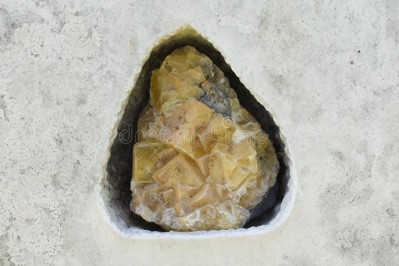 Yellow fluorite inbeded in stone surface, Dresden, Germany royalty free stock photo