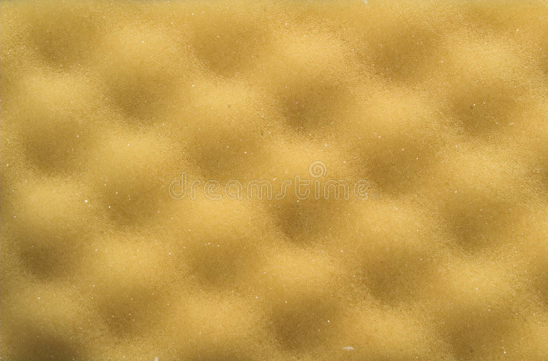 Yellow foam rubber texture. With bumps stock photography