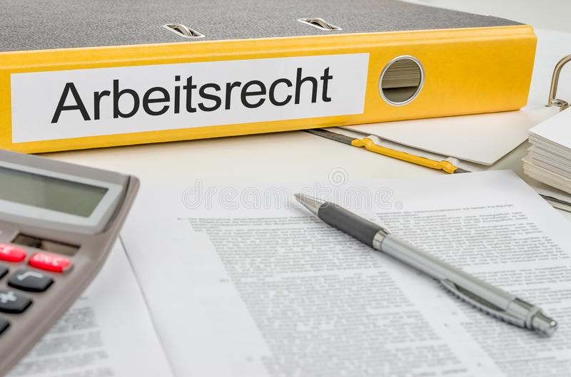 Yellow folder with the german label Arbeitsrecht - Labour Law royalty free stock photos