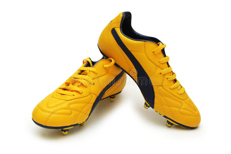 Yellow football boots stock image