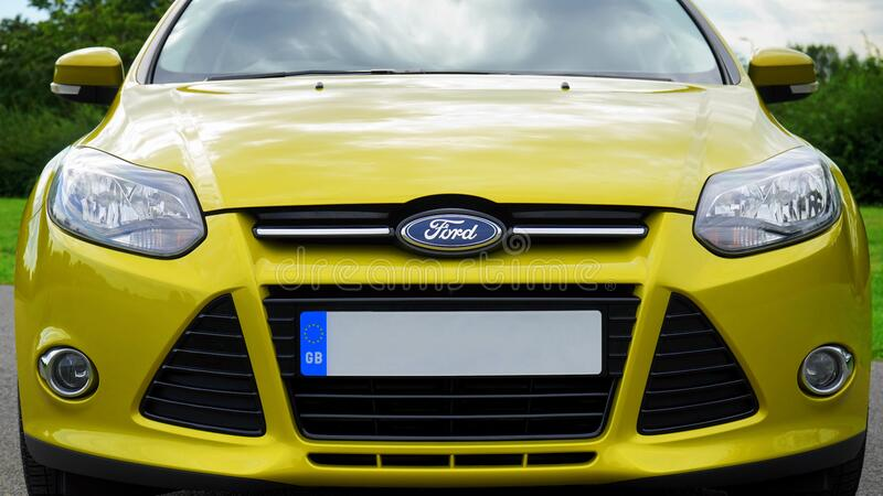 Yellow Ford motor car royalty free stock image
