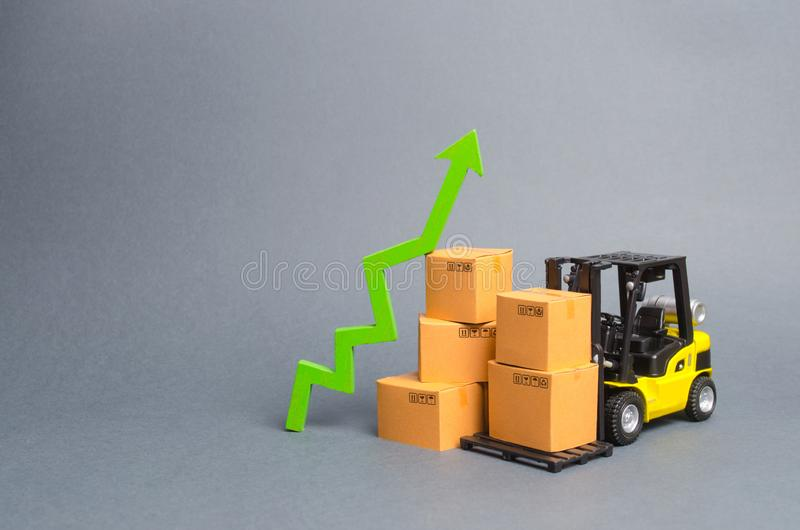 Yellow Forklift truck with cardboard boxes and a green arrow up. growth rate of production goods and products, raise economic. Indicators. Increasing consumer royalty free stock image