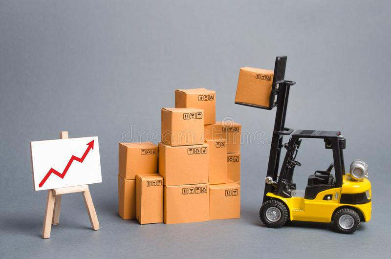Yellow Forklift truck with cardboard boxes and a red arrow up. Increase sales, production of goods. Improving consumer sentiment royalty free stock photos