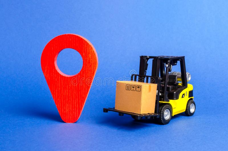 Yellow Forklift truck carries a box next to red pointer location. Services transportation of goods, products, logistics stock photos