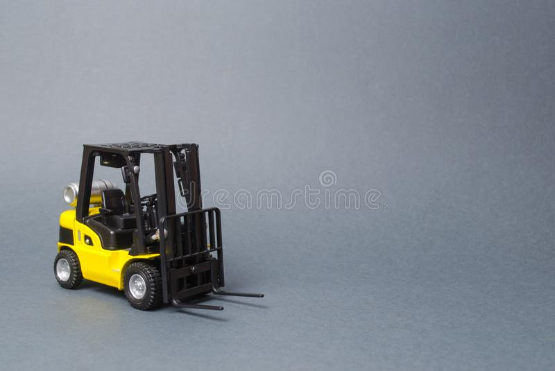 Yellow forklift truck on gray background. Warehouse equipment, vehicle. Logistics and transport infrastructure, industry stock image
