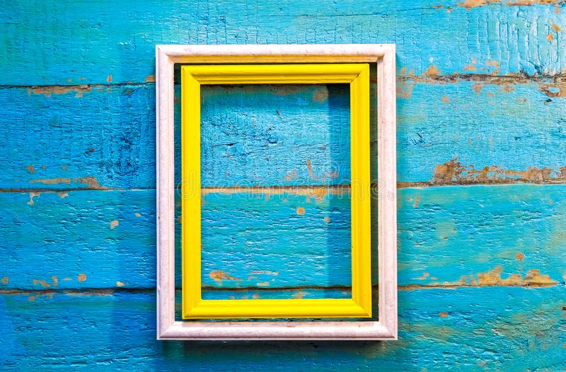Yellow frame inside a white frame for photos and images with a blank space inside royalty free stock image