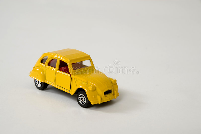 Yellow french car. A miniature Frech yellow car royalty free stock photos