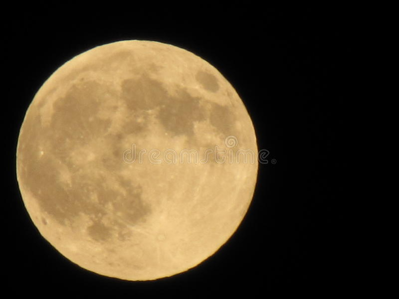 Yellow full moon on the dark night, close up, royalty free stock image