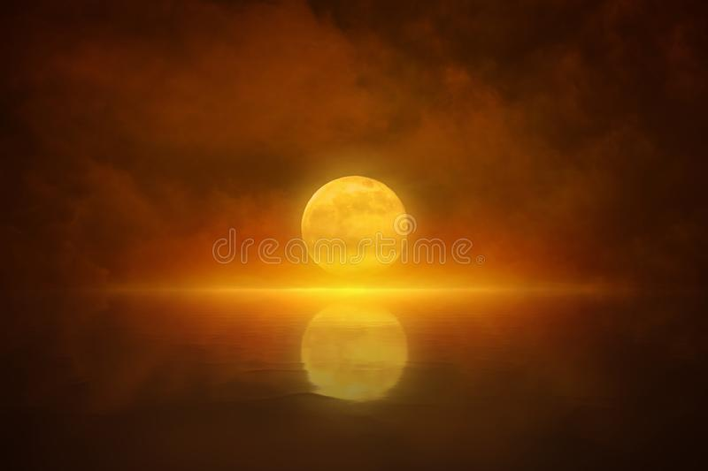 Yellow full moon rises in red glowing sky. Dramatic mystical background - yellow full moon rises in red glowing sky. Elements of this image furnished by NASA royalty free stock images